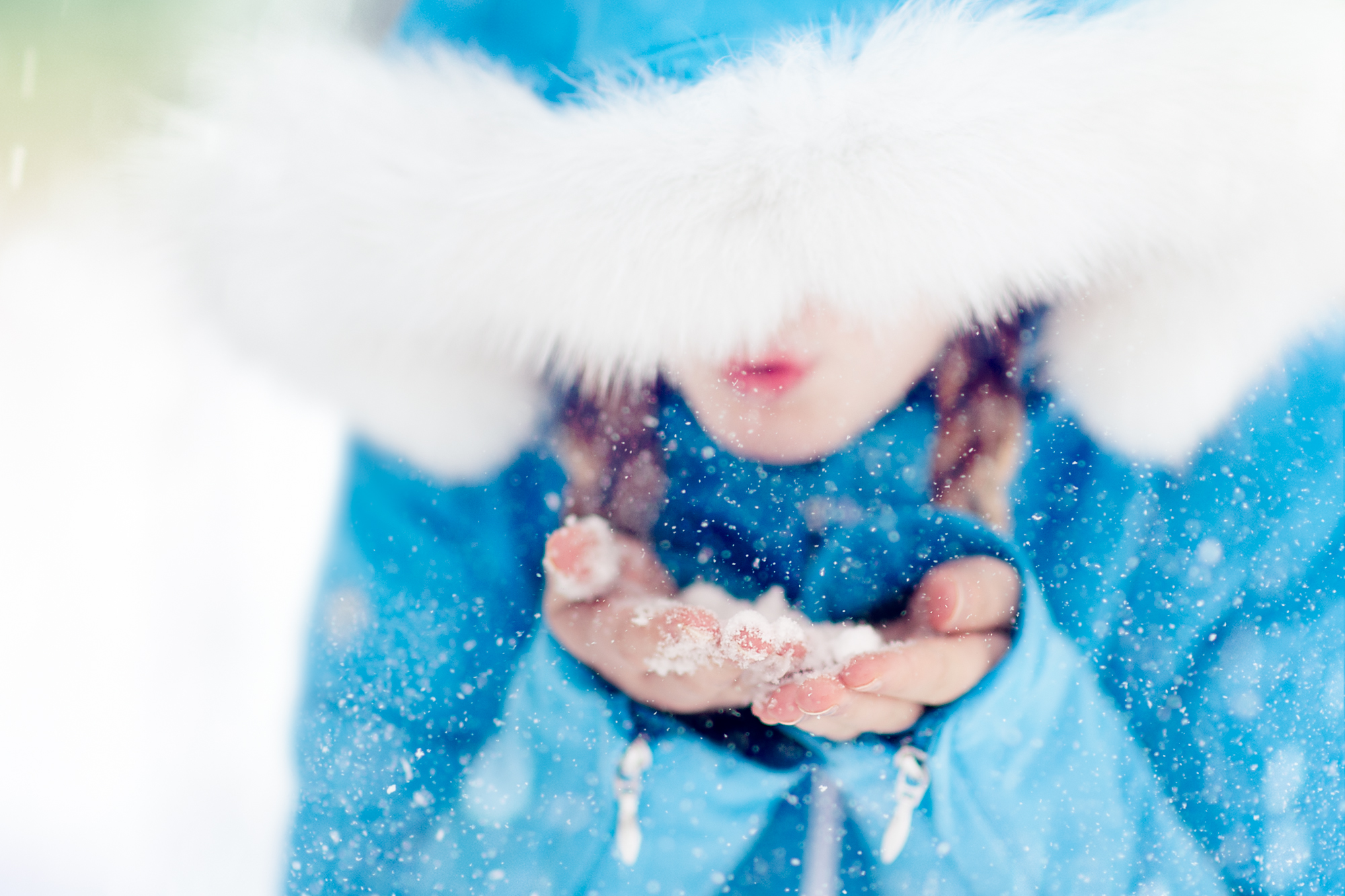 girl blowing snowflakes