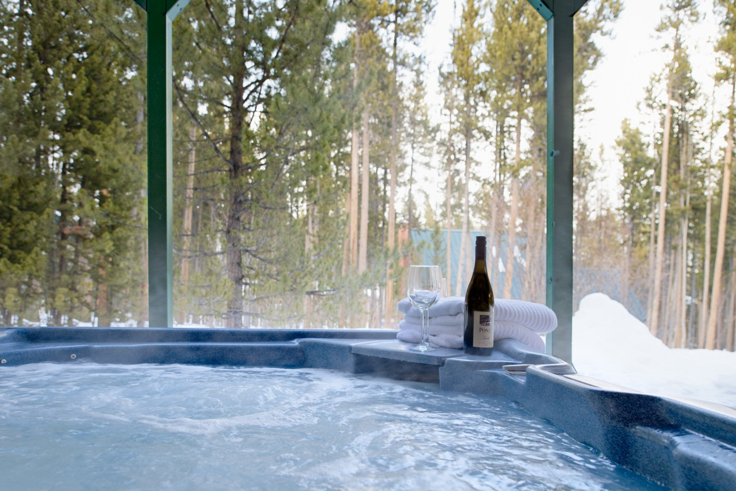Private hot tub with a view to the surrounding pines ... your seat in the hot tub awaits
